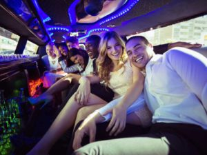 Friends having a party with American Luxury Limousine
